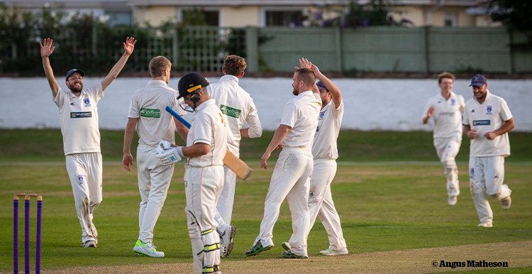 Andrew's cricket teams celebrating a wicket