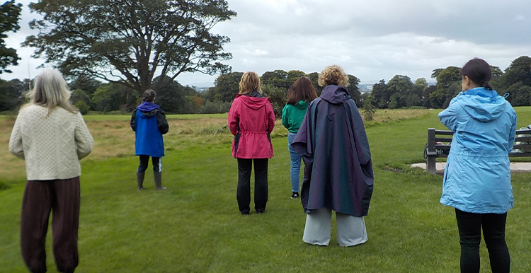 Group taking part in Qi Gong run by Growing Sudley