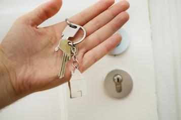 Hand holding house keys